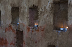 Candles in the brick wall. Candles in the niche of the brick wall Stock Photography