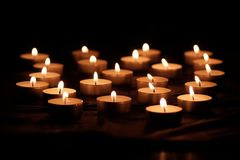 Burning candles with bright flames stock photography