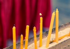 Candles in Buddhism temple closeup Stock Photo
