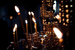 Candles burn in Church Stock Images