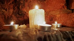 Candles burn in the dark. A few candles burn in the dark stock video footage