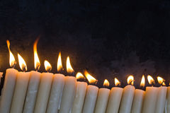 Candles. Burning against a black background royalty free stock images