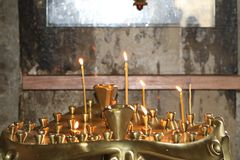 Candles are burning and brightening into church royalty free stock images