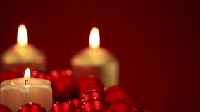 Candles burning in christmas ball ornaments stock video footage