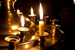 Candles  burning in the church. Candles burning in the orthodox church at night Royalty Free Stock Photography