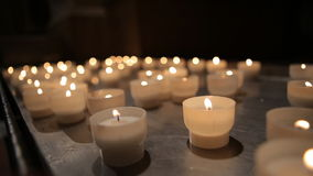 Candles burning in a church stock video