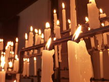 Candles burning in the church Royalty Free Stock Images