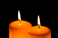 Candles burning in the dark Stock Photo