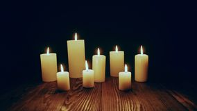Candles burning in dark. Toned locked down video stock video footage