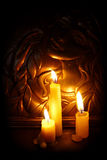Candles burning in darkness. On a background girl image Royalty Free Stock Photo