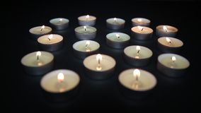 Candles burning in the darkness. Candles burn in the dark on the table stock video footage