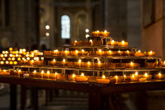 Candles burning inside church Stock Photography