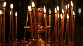 Candles burning in the orthodox church. stock video footage