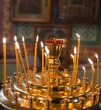 Candles burning in orthodox church.  Royalty Free Stock Images