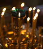Candles burning in orthodox church. Photos in the studio Stock Photo