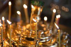 Candles burning in orthodox church. Photos in the studio Stock Image