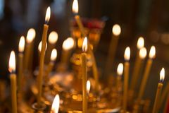 Candles burning in orthodox church. Photos in the studio Royalty Free Stock Image