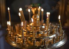 Candles burning in orthodox church. Photos in the studio Royalty Free Stock Photos