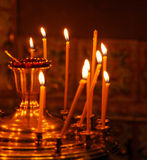 Candles Burning in Orthodox Church Stock Images