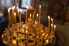 Candles burning in orthodox church. Photos in the studio Royalty Free Stock Photography