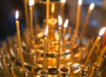 Candles burning in orthodox church. Photos in the studio Stock Images