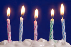 Candles in cake stock photography