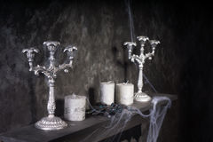 Candles and Candelabras on Creepy Mantle Stock Images