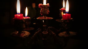 Candles in candelabrum with five branches in full dark Royalty Free Stock Photo