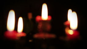 Candles in candelabrum with five branches in full dark Royalty Free Stock Photos