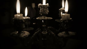 Candles in candelabrum with five branches in full dark Royalty Free Stock Image