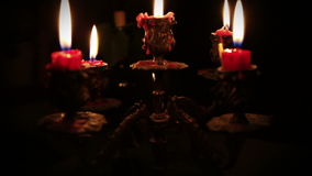 Candles in candelabrum with five branches in full dark Stock Image