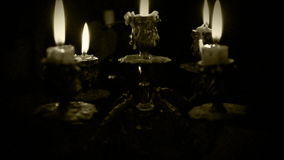 Candles in candelabrum with five branches in full dark Stock Photo