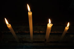 Candles on candle holder at church Stock Photos