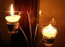 Candles and Candlestick. Two small candles and a modern candlestick stock photo