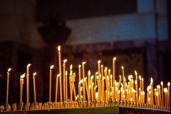 Candles. At tick in Church royalty free stock images