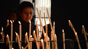 Candles at candlestick in church stock video footage