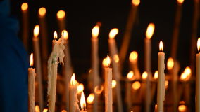 Candles at candlestick in church stock footage