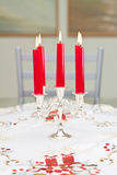 Candles in a candlestick on a table. Five canles on a table in a candlestck Stock Image