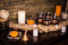 Candles and candlesticks on a wooden table royalty free stock photos