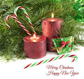 Candles with canes and conifer Stock Images