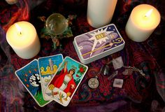 Candles and cards. Occult items, including my hand drawn tarot deck, and a silver pentagram Royalty Free Stock Photos