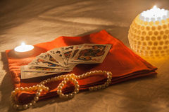 Candles, cards and pearl Royalty Free Stock Image