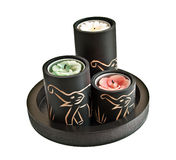 Candles with carved elephants Stock Photo