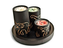 Candles with carved elephants on them Royalty Free Stock Photos