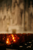 Candles in a cathedral. Prayer candles in front of statue at St. Patrick's Cathedral in New York, Ny Royalty Free Stock Photography