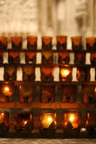 Candles in cathedral. Rows of prayer candles in St. Patrick's Cathedral New York, NY Stock Images
