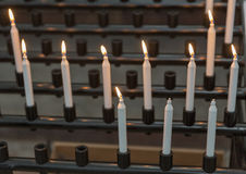 Candles in cathedral - religion background royalty free stock image
