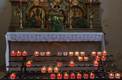 Candles in cathedral - religion background royalty free stock photos