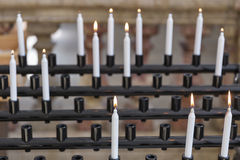 Candles in cathedral - religion background, focus on foreground Royalty Free Stock Image
