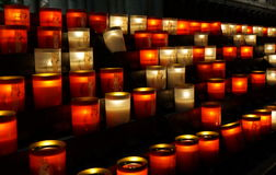 Candles at catholic temple stock images